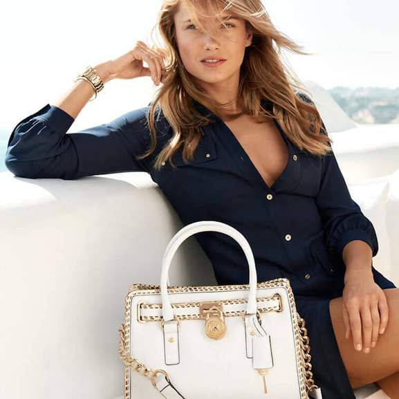 Woman wearing blue Michael Kors Dress with Michael Kors Women's Watch and Michael Kors Bag in White