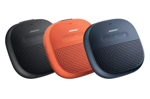 bose soundlink micro speaker in black, bright orange and midnight blue