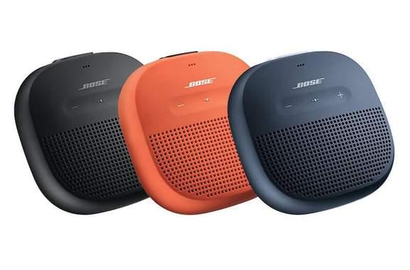 bose soundlink micro speaker in black, bright orange and midnight blue