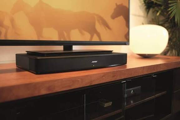 bose solo soundbase standing under a tv