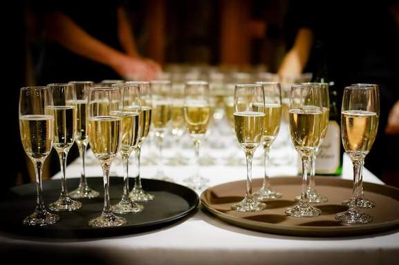 champagne flutes on a dinner tray