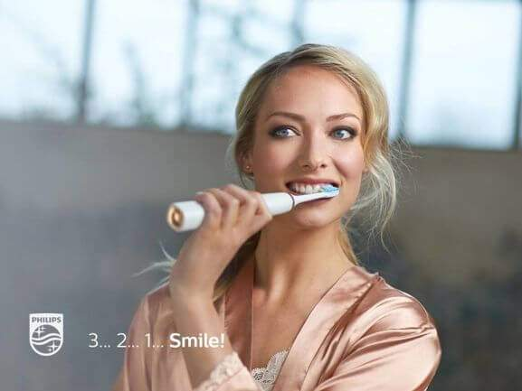 woman has a 3, 2, 1 smile with philips sonicare
