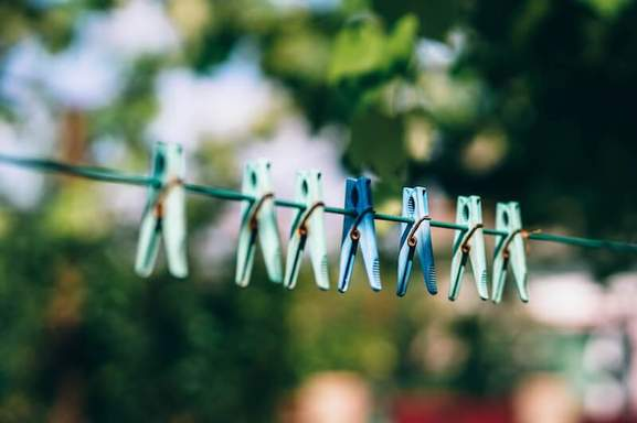 isolated plastic laundry clips with a blurred background