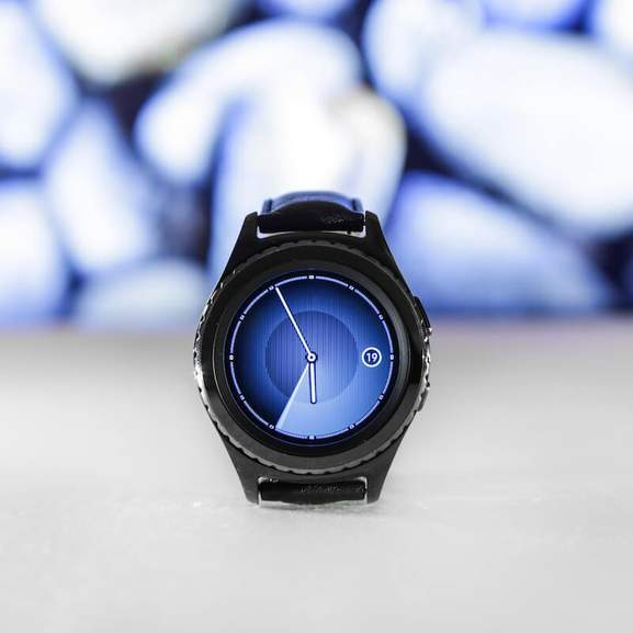Samsung Galaxy Watch 42mm Black in front of blue background