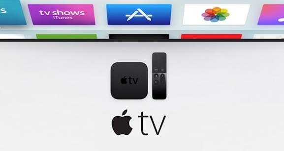 Apple TV box and Siri remote in front of TV set