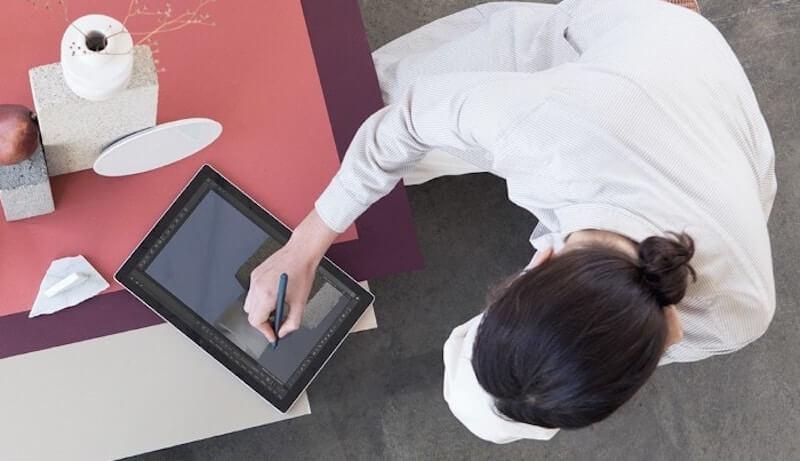 Woman using Microsoft Surface Pro