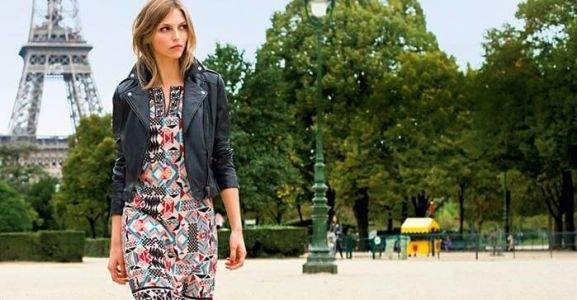 a model wearing a la redoute dress and a leather jacket in paris