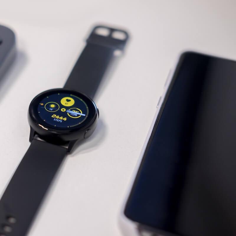 Samsung Galaxy Watch Black next to Samsung Phone