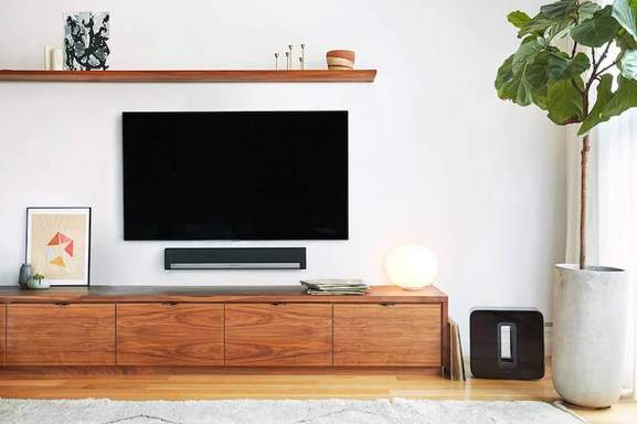 sonos playbar hanging on the wall in a living room