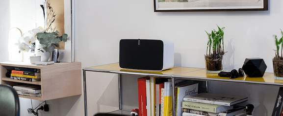 sonos play 5 standing on a shelf in a living room