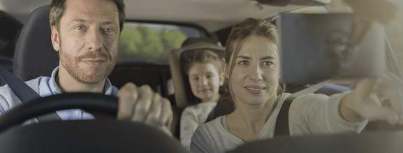 family sitting in a car using a satellite navigation system