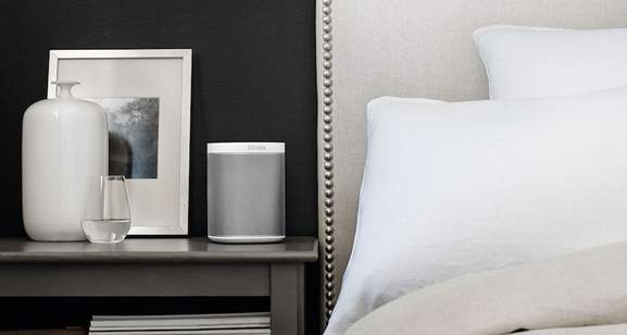 bedroom in clean colors with a sonos play 1