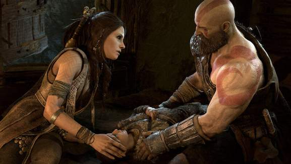 a dark haired woman is touching kratos' knee