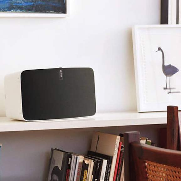 White Sonos Play:5 on side counter next to picture