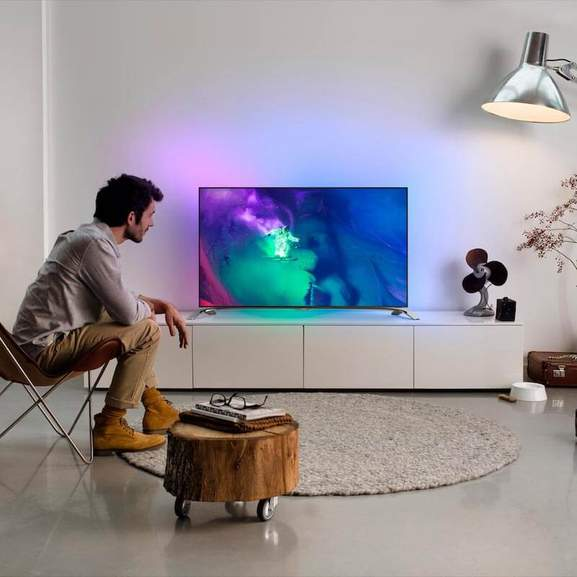 Man watching Philips TV with ambilight