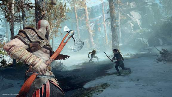 kratos with a battle axe and atreus with a bow are fighting a monster in a snowy wood