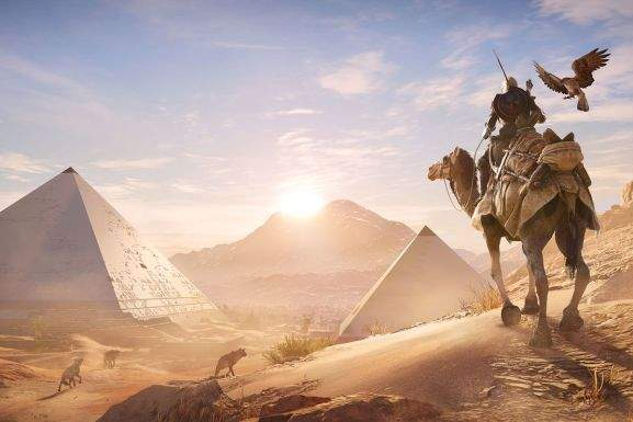 bayek on a camel standing in front of two pyramid tombs