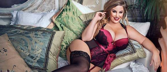 a model in a lingerie lying on a couch