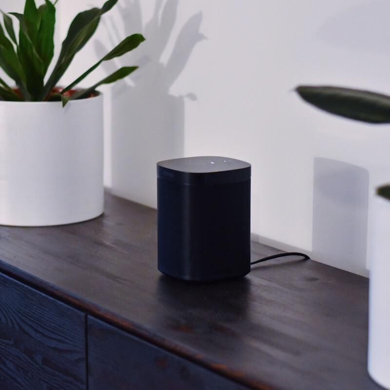 Sonos One Black on wooden side