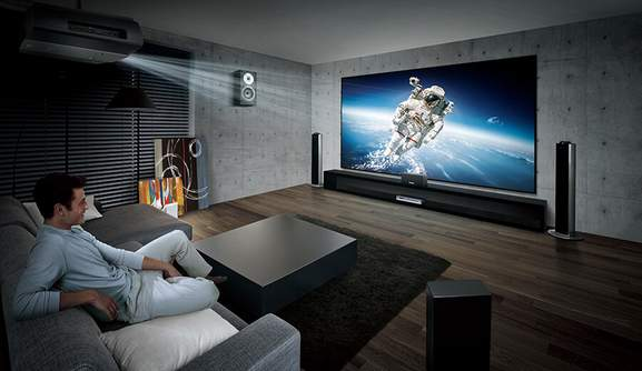 man is watching a science documentary in a home theatre