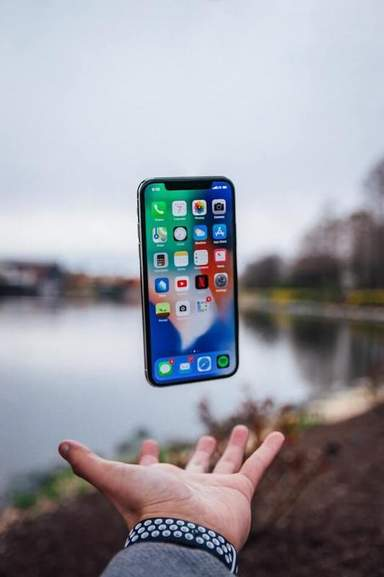 iPhone X over hand
