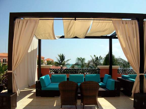 outdoor lounge area in a tropic environment