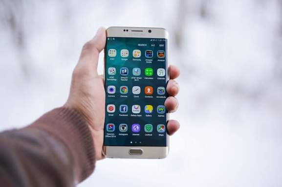 Person Holding Silver Samsung Galaxy Smartphone