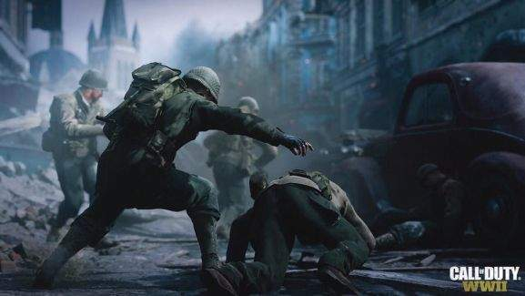 soldiers are running away in a destroyed city one is stumbling