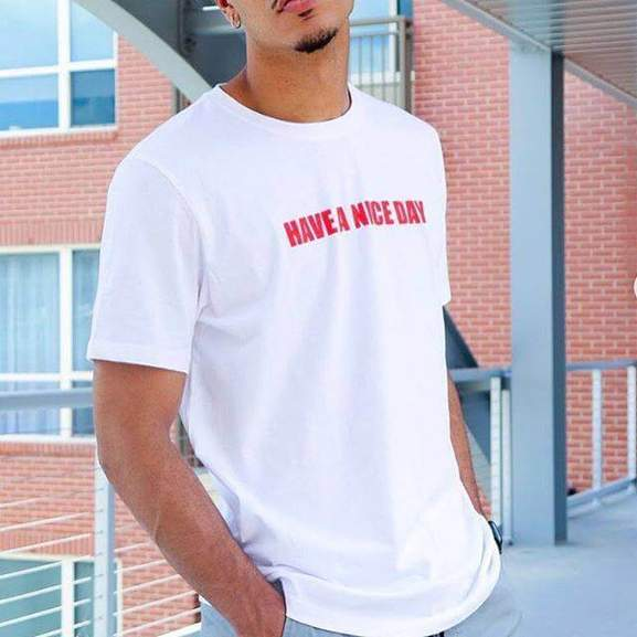 men wearing a white have a nice day shirt