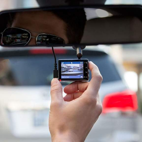 person using front facing dash cam