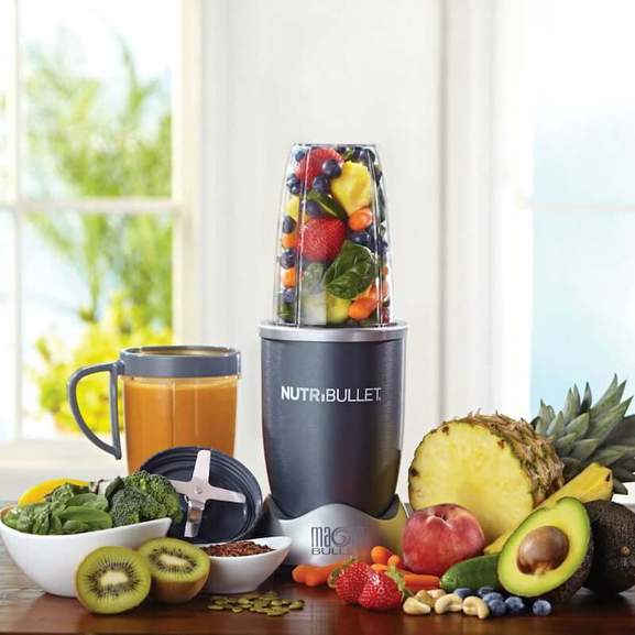 NutriBullet surrounded by fruit