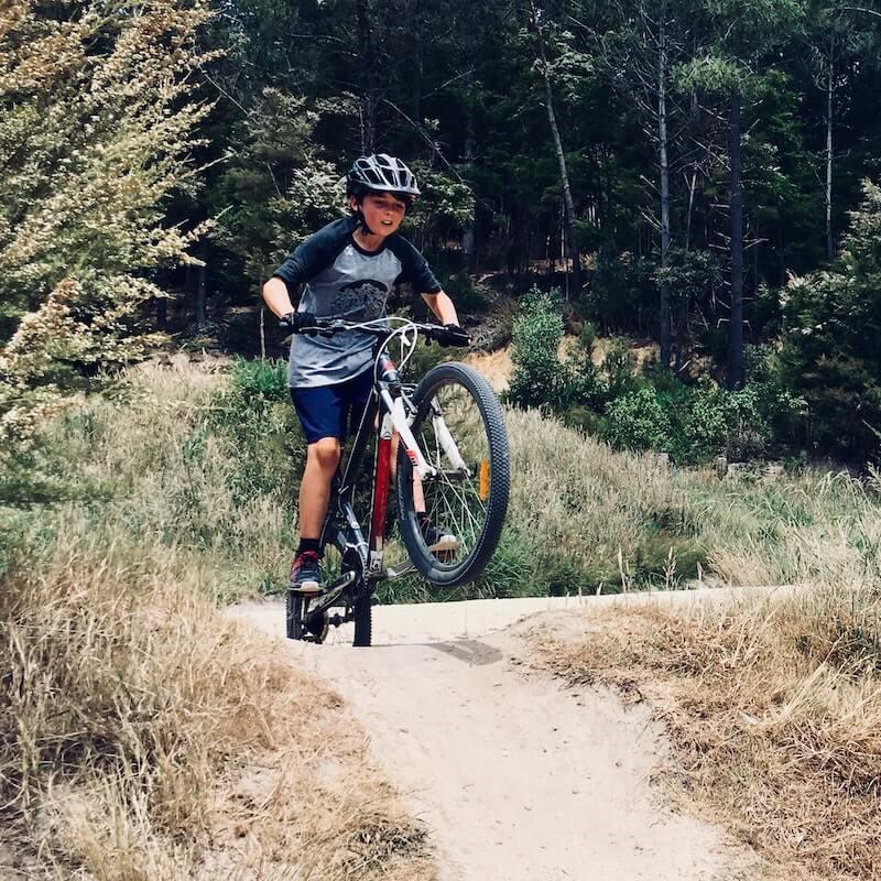 kid on mountain bike
