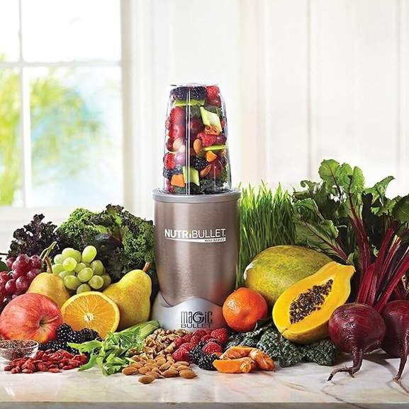 NutriBullet 900 surrounded by fruit