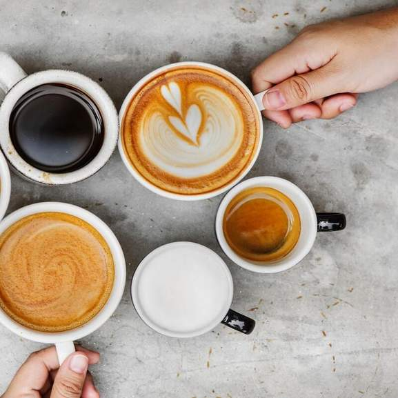 5 coffee cups with hand
