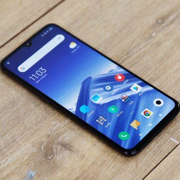 Xiaomi Mi 9 on wooden background
