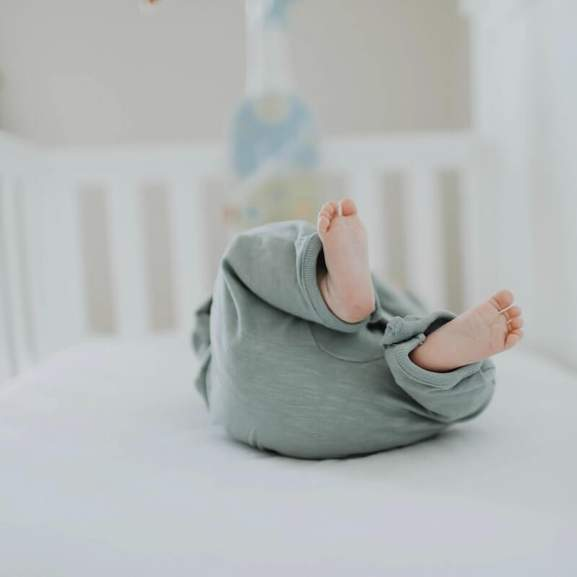 baby in cot