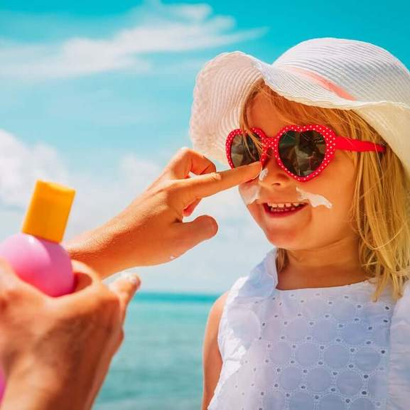 Kids sun cream on face of children