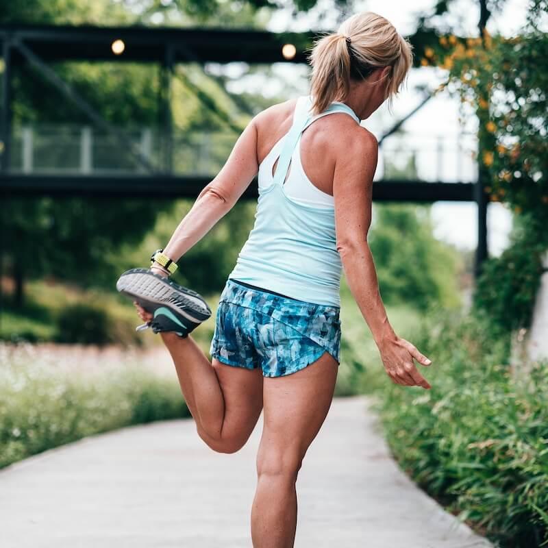 Woman streching in nike running shoes