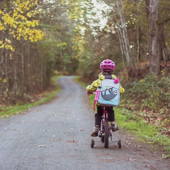 girl riding bike in countryside