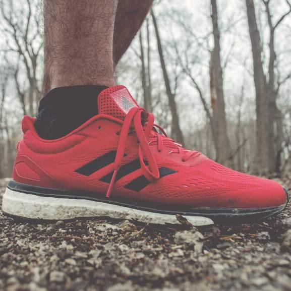 Red adidas running shoes