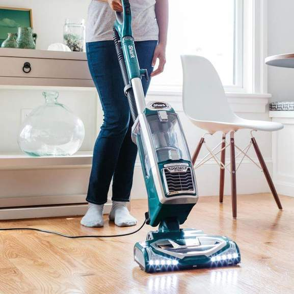 Blue Shark Vacuum with lights cleaning wooden floor