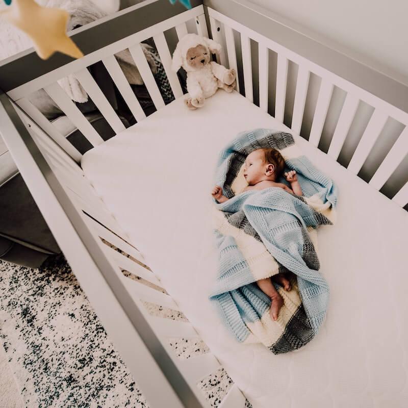 newborn in cot