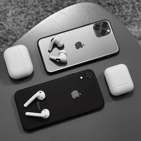 Apple Airpods Pro on iPhone 11 Pro next to Airpods 2 on iPhone X