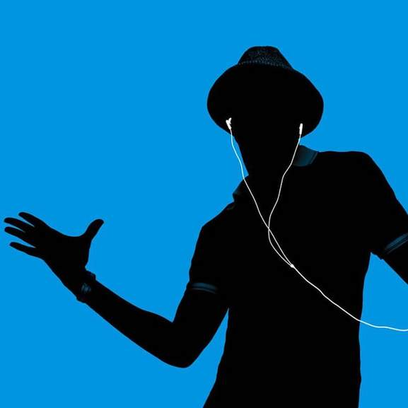 Silhouette of person dancing with apple earpods