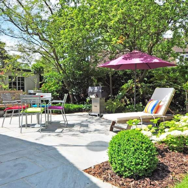 Garden Parasol with garden furniture and gas bbq