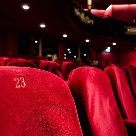 Red seats in Cinema with gold 23
