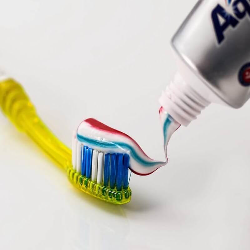 toothpaste on brush