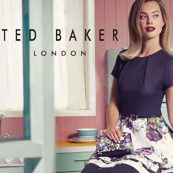 Ted Baker logo next to woman wearing ted baker womens clothes