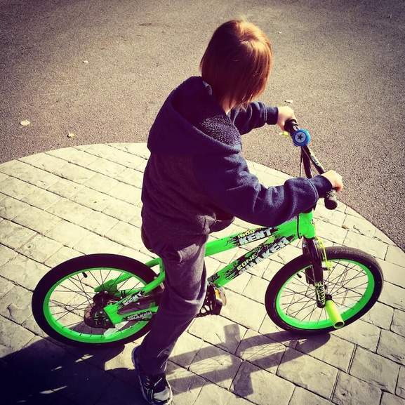 boy on stunt bike