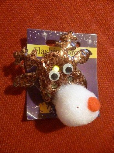 Gold reindeer flashing badge ... £1.00 in Poundland